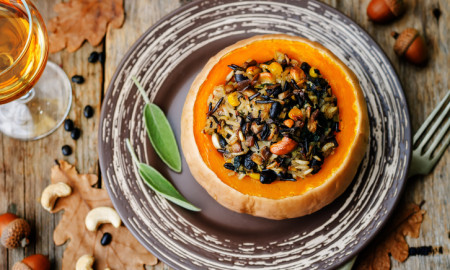 pumpkin stuffed with rice, black beans, corn, cashews and mushrooms. the toning. selective focus