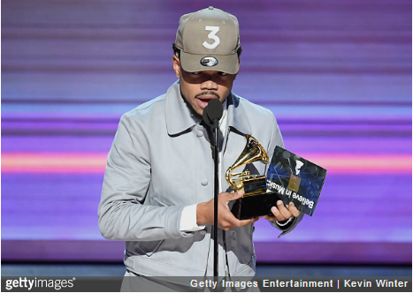 Recording artist Chance the Rapper accepts the Best Rap Album award for 'Coloring Book' onstage during The 59th GRAMMY Awards at STAPLES Center on February 12, 2017 in Los Angeles, California. (Photo credit: Kevin Winter/Getty Images for NARAS)