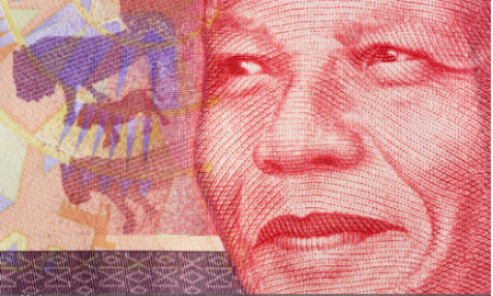 Close-up of a new South African Fifty Rand banknote, featuring the face of iconic statesman Nelson Mandela, with various animals and African designs as part of the design and watermarking. (Photo credit: RapidEye/Getty Images)