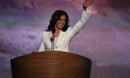 Kamala Harris, attorney general of California, waves before speaking during day two of the Democratic National Convention (DNC) in Charlotte, North Carolina, U.S., on Wednesday, Sept. 5, 2012.  (Photo credit: Scott Eells/Bloomberg via Getty Images)